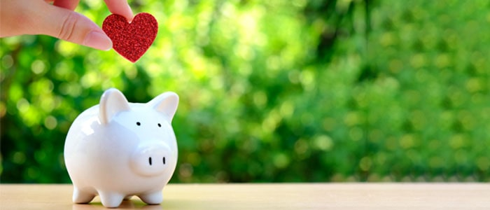 piggy bank with a heart being put in it