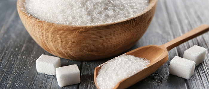 a bowl and spoon on white sugar